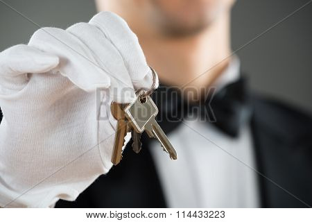 Midsection Of Waiter Holding Keys
