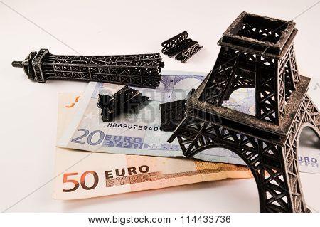 Broken Eiffel tower on money