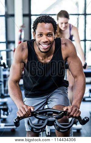 Fit man working out at class in the gym
