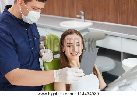 Beautiful healthy woman came to visit her dentist