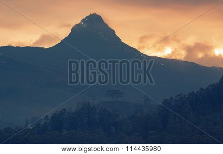 Mountain of Adam's Peak (2243m, 7359ft) at sunset. Sri Lanka
