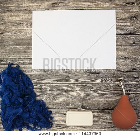 Excellent mockup  with blue wool, soap, orange watering felting on a wooden background.