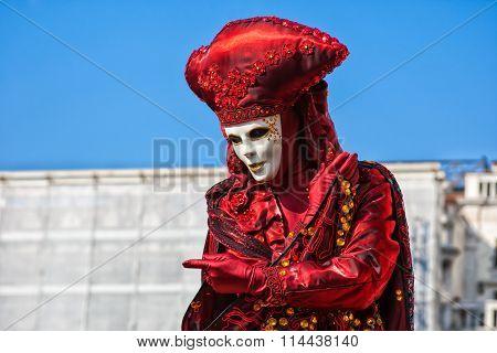 Carnival mask in St Mark's Square, Venice, Italy