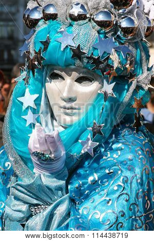 Venetian Mask in beautiful Carnival Costume in Venice, Italy