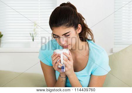 Sick Woman Holding Tee Mug At Home