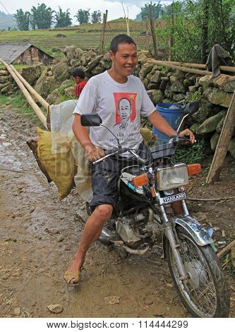 man is carrying some cargo by motorbike in village CatCat, Vietnam