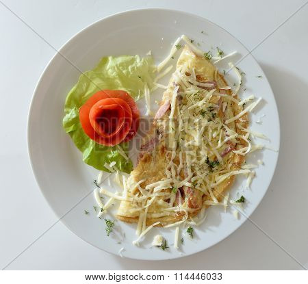 omelette with salad tomato and cheese on a white plate isolated