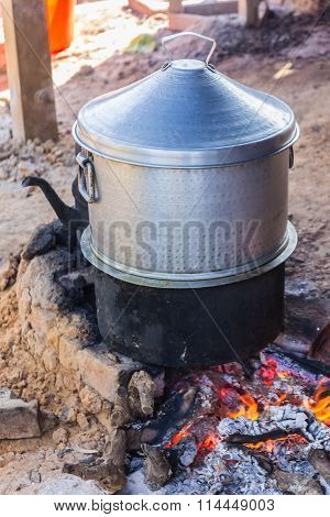 Rice Cooking With Pot On Charcoal Brazier