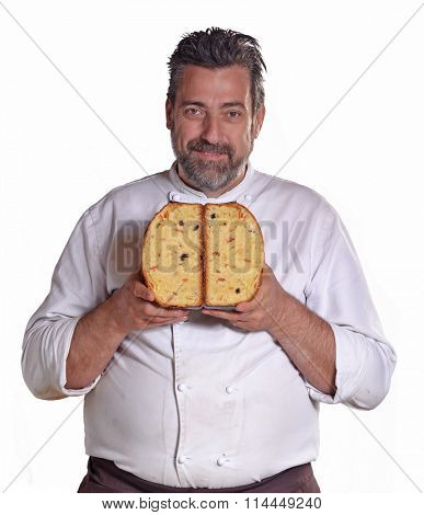Baker portrait holding sliced panetone bread on white background.