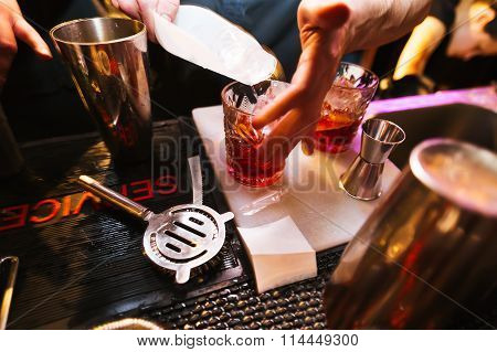 Bartender preparing a cocktail. Glass on the bar