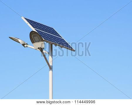 Solar Panels With Led Lamp Over Blue Sky