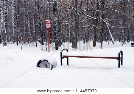 Bench And Trashcan In Snow