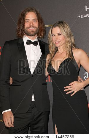 BEVERLY HILLS, CA - JAN. 10: Christopher Backus & Mira Sorvino arrive at the Weinstein Company & Netflix 2016 Golden Globes After Party, Jan. 10, 2016 at the Beverly Hilton Hotel, Beverly Hills, CA.