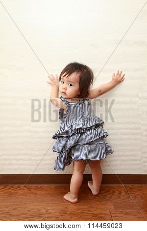 Japanese baby girl pulling up to standing (0 year old)