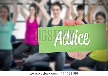 The word advice and hand showing card against