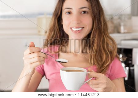 Woman In The Kitchen Having Coffee With Sugar