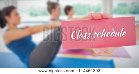 The word class schedule and hand showing card against