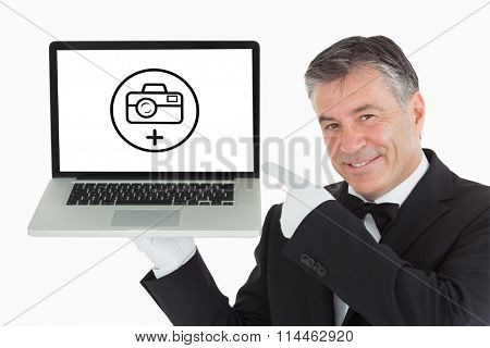 Photography apps against smiling waiter pointing us something on a laptop