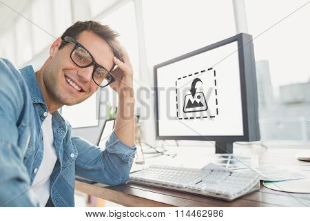 Portrait of a casual businessman posing and smiling against photography apps Portrait of a casual businessman posing and smiling in the office