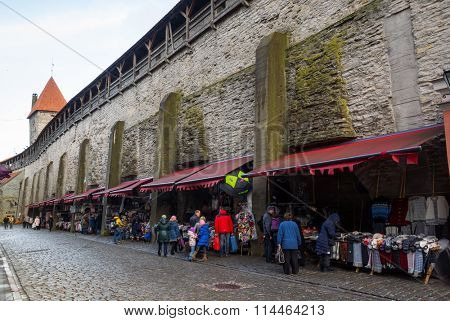 TALLINN, ESTONIA - DECEMBER 25: People buying souvenirs in old city on December 25, 2015 in Tallinn, Estonia