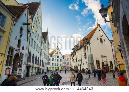 TALLINN, ESTONIA - DECEMBER 25: People walking on the street in old city on December 25, 2015 in Tallinn, Estonia