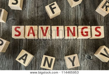 Wooden Blocks with the text: Savings
