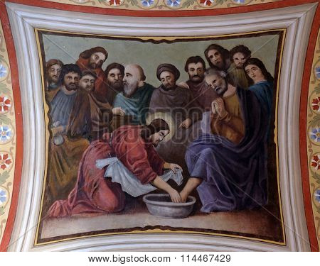 STITAR, CROATIA - AUGUST 27: Jesus washes the feet of Peter, fresco in the church of Saint Matthew in Stitar, Croatia on August 27, 2015