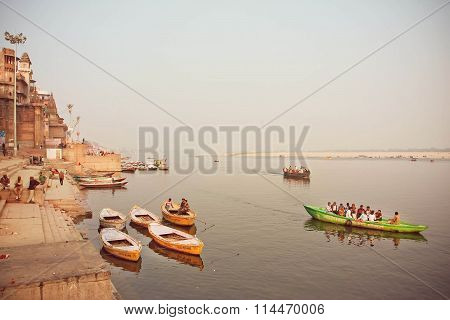 River Dock Area With Riverboats At Evening On Sacred River Ganges