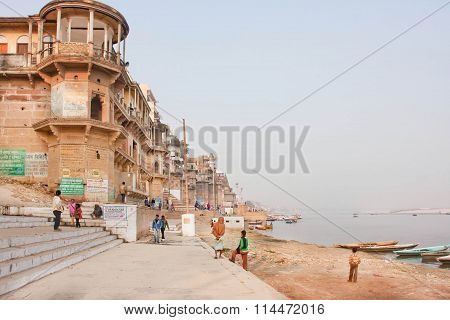 Monumental Buildings Under Riverboats On Sacred River Ganges