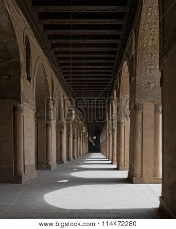 CAIRO, EGYPT - September 12 2015: Corridor Of A Historic Mosque With Arches And Wooden Ceiling