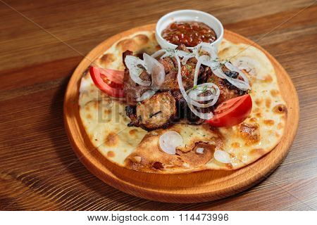 Shish kebab on bread. Tasty and healthy food, European cuisine.