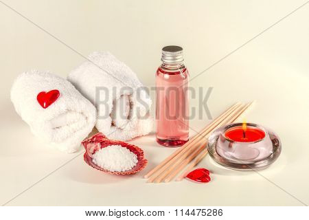 Spa background with erotic massage oil and towels. Toned image.