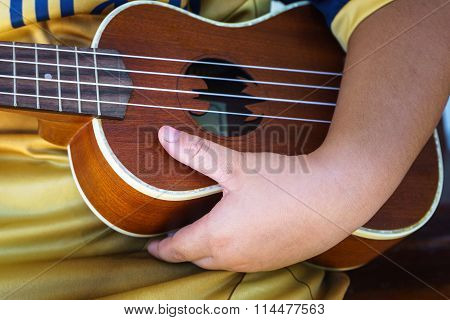 Playing Ukulele Guitar When Young
