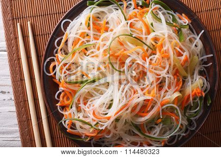 Chinese Noodles With Cucumber And Carrot Close-up. Horizontal Top View