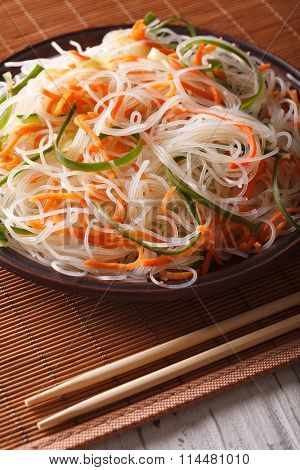 Chinese Noodles With Cucumber And Carrot Close-up. Vertical