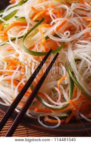 Glass Noodle Salad With Cucumber And Carrot Close-up. Vertical