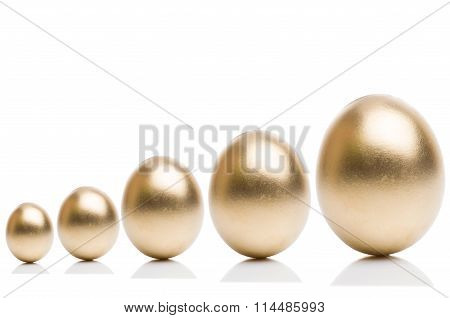 Golden eggs from  isolated on a white background.