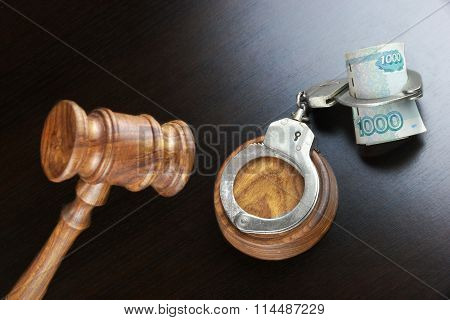 Judges Gavel, Handcuffs And  Russian Cash  On The Black Table