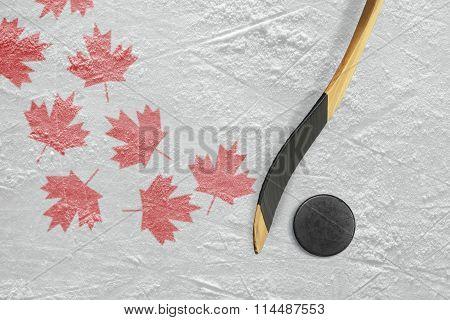 Hockey Puck, Hockey Sticks And Maple Leaves