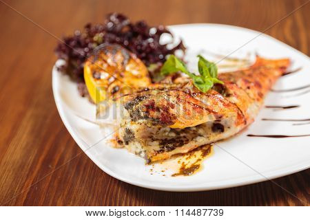 Grilled fish with grilled vegetables and sauce