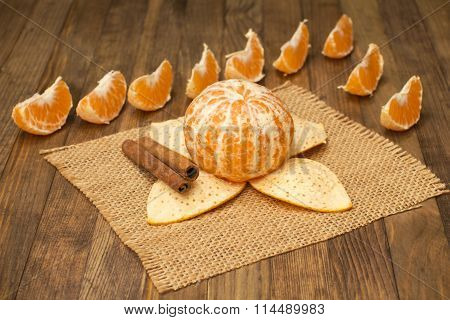 Two Stick Cinnamon And Mandarin Fruit On Wooden Background