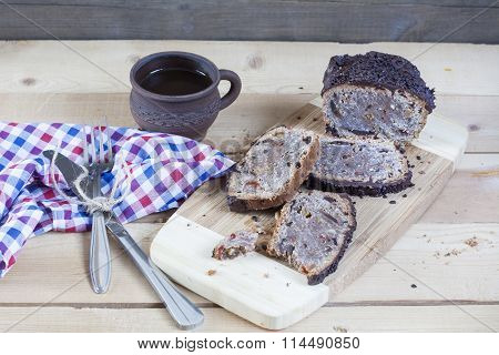 Stollen traditional German Christmas yeast cake with raisins served with a cup of coffee