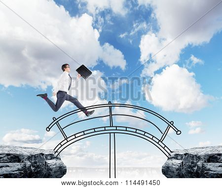 Businessman Crossing A Bridge