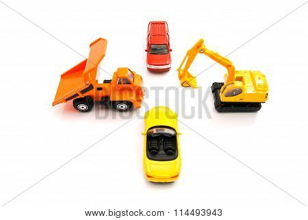 Truck, Backhoe And Other Cars On White