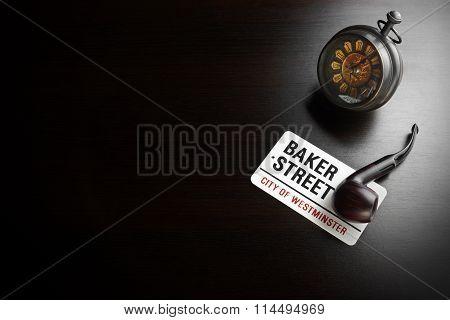 Baker Street Sign And Sherlock Symbol On Black Table
