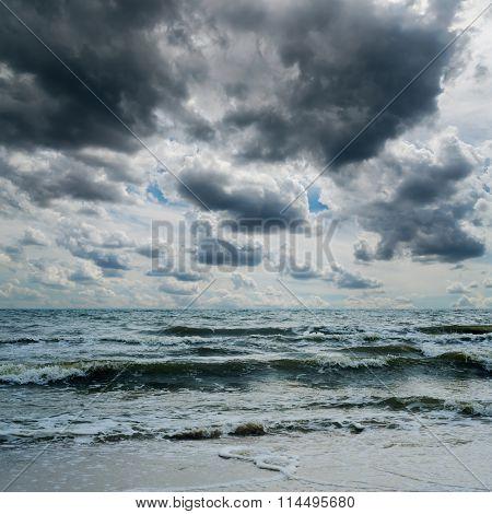 stormy sky over dark sea