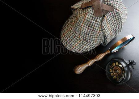 Sherlock Deerstalker Hat,  Vintage Clock And Magnifier On Black Table