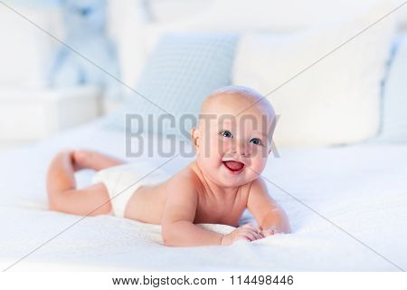 Baby Boy On White Bed