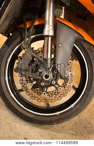 The front wheel of a motorcycle.