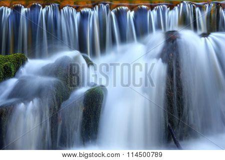 waterfall cascades and stone closeup